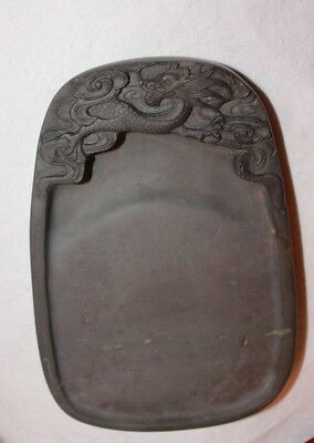 Chinese ink stone with sculptured dragon in custom wood box, age unknown