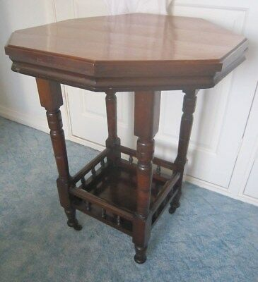 Victorian octagonal wood 2 tier parlour table in need of some TLC (on casters)