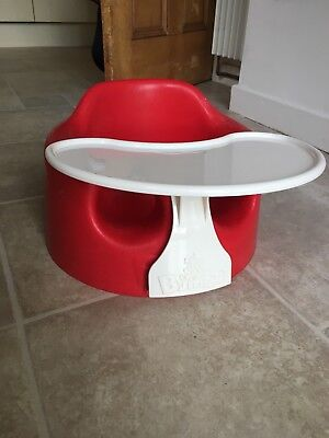 Red bumbo seat with tray