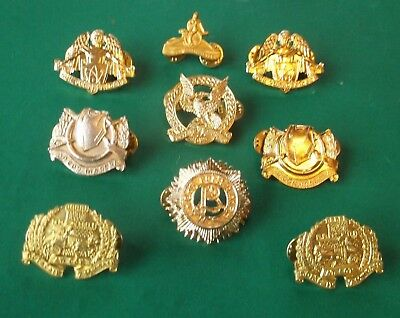 a job lot of 9 Irish Defence Forces staybright Badges