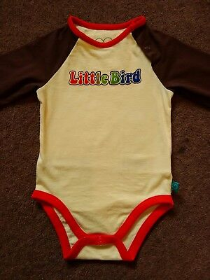 6-9 months. Immaculate cond little bird by jools bodysuit with 70's logo.