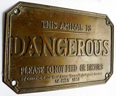 """Antique or Vintage Brass Sign which reads:  """" This Animal is Dangerous """""""