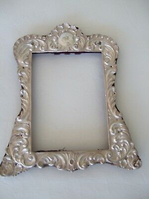 Antique silver ornate tabletop picture frame.