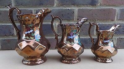 Graduated Set of 3 Victorian Diamond Moulded Copper Lustre Jugs