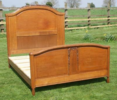 AN EARLY 20th CENTURY FRENCH OAK ART DECO DOUBLE BED WITH BASE