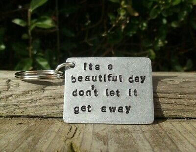 U2 keyring Its a beautiful day don't let it get away Gift Bagged Lyrics Music