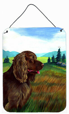 Carolines Treasures  7122DS1216 Sussex Spaniel Aluminium Metal Wall or Door Hang