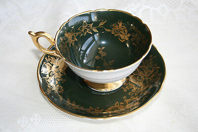 COALPORT tea cup and saucer, dark green and gold orchid floral pattern.