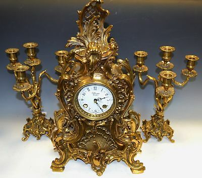 French Louis XV Rococo style Brass Mantel Clock and candlesticks K Mozer