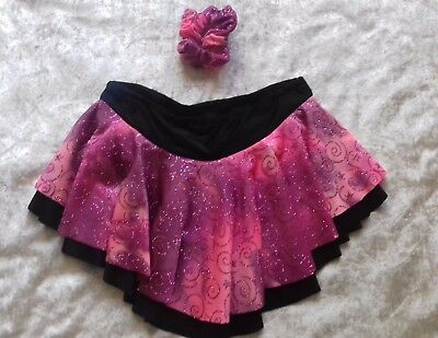 Ice skating skirt with a matching hair scrunchie.
