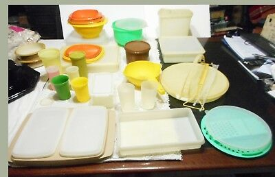 Assorted Plastic Tupperware Containers And Cups Some New