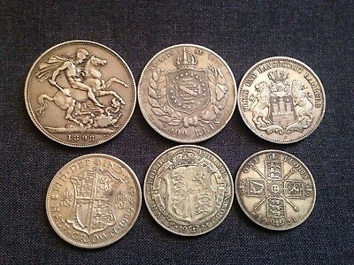 group of silver coins British 1898 crown,1923/ 29 half crown,1921 florin,