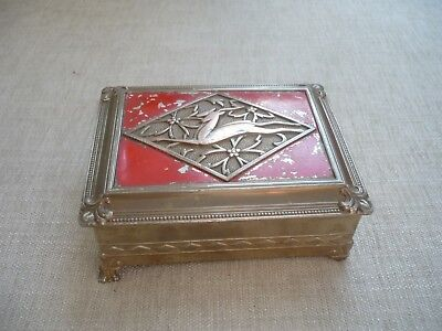 Pretty stylised Art Deco red enamel box depicting leaping stags in diamond