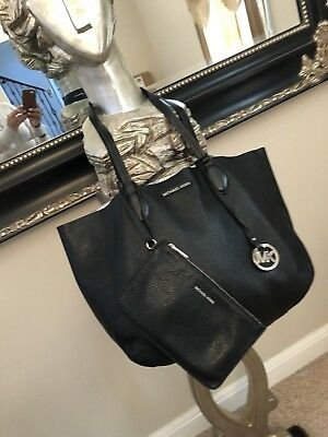 46ce396c9863 Michael Kors Medium Reversible Tote Bag Black /Silver with black Clutch