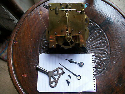 Antique / vintage clock movement / hands / key. for parts,