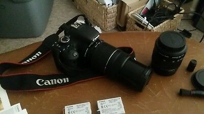 Canon EOS Rebel T3i + 2 lenses + 2 batterys + 5' tripod + remote + carry bag