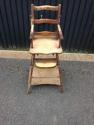 Antique wooden high chair, well-used by four generations of my family.