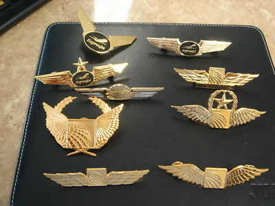 9 Continental  Airlines Wings and Hat Badges