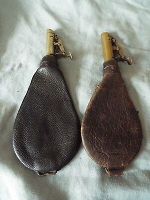 A pair of antique brass and leather shot flask