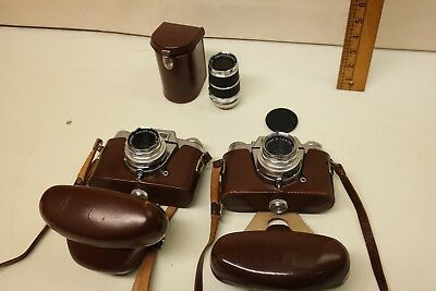 Two vintage Voigtlander Bessamatic cameras with extra lense.