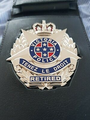 RETIRED Victoria Police badge Tenez Le Droit with leather wallet.