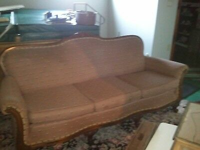 Antique matching Victorian couch and chair with ornate wood carving