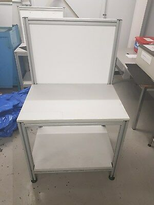 White and grey work bench / display table.
