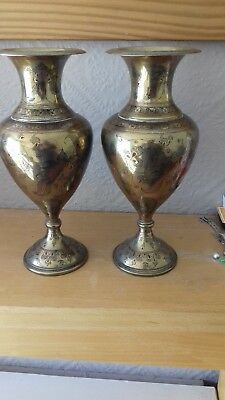 A pair of Indian brass decorative vases