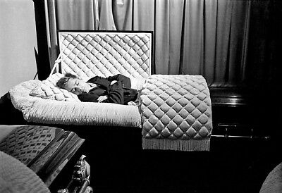 James Dean poses for fun in a casket in a funeral parlor in 1955.