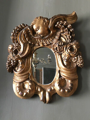 Wonderful 18th century gerogian carved giltwood and gesso wall mirror Circa 1740