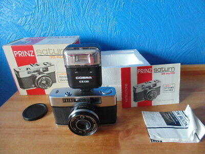 Immaculate Prinz Saturn 35 Auto( Halina 35-600). Boxed With Manual And Flash Gun