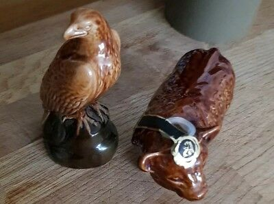 Beswick Decanters Golden Eagle and Bull with stoppers and seal still intact.