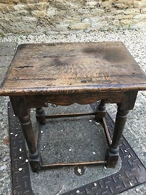 antique small table in dark wood