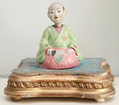 A c19th Porcelain Seated Oriental Figure with Nodding Head