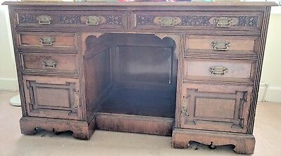 Large antique solid wood desk. Leather inlaid top. 6 drawers, 2 cupboards.