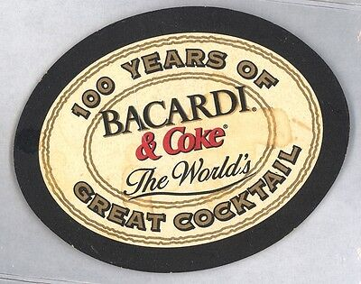 Rare OVAL  Bacardi & Coke coaster - 100 years of Great cocktail - History back