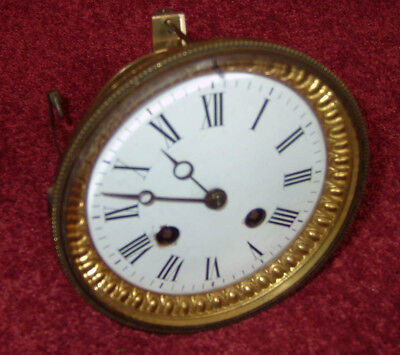 French striking clock movement complete with dial & bezel, working