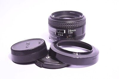 Lens Nikon AF Nikkor f/2.8 - 28mm with plugs and pare Sun. Mint