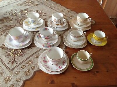 Beautiful collection of 15 antique cups and saucers each with a cake plate