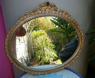 Large antique oval mirror in a plaster gilt frame - very good cond