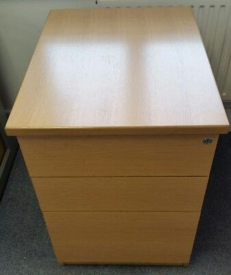 A Three-Drawer Desk-Height Light-Wood Desk/filing Pedestal.
