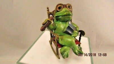 Boss Frog in Metal Rocking Chair with Cigar and book