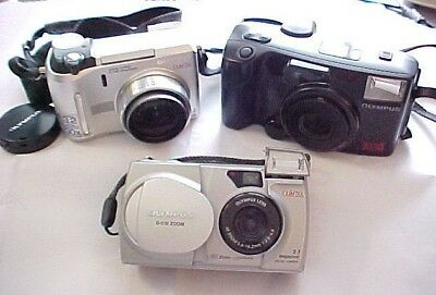 Lovely wholesale lot of (3) clean Olympus cameras, two digital and one 35 mm.