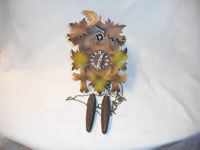 Vintage cuckoo clock with weights