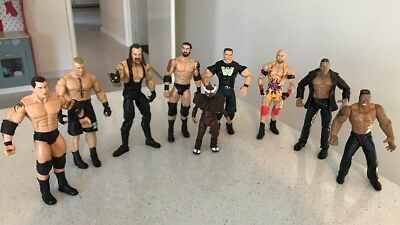 WWE WRESTLING ACTION FIGURES LOT OF 9 The Rock Fast Free Post