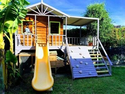 Kids cubby house, made by Cubbykraft. Includes slide, rock climbing wall, steps