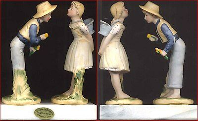 Boy & Girl Ceramic Figurines Pair on Marble Base Dimensions 15cm high x13cm Wide