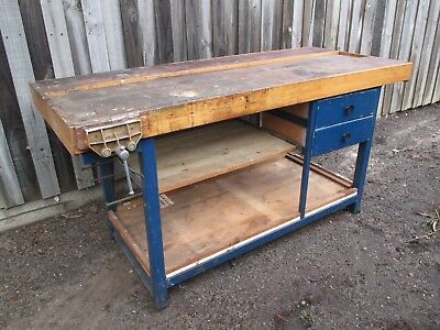 Workbench table with 2 drawers and a vice.