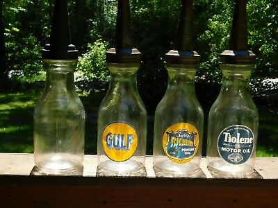 4 glass motor oil bottles
