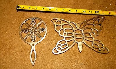 2 Brass footed Trivets, one butterfly, one ornate. good condition